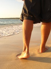 PICTURE OF PERSON WALKING ON BEACH FOR POST TOE SEPARATORS FOR OVERLAPPING TOES