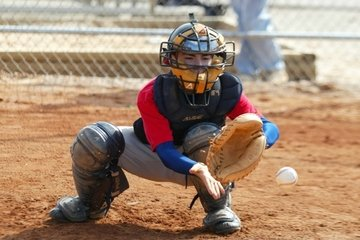 Child playing catcher in baseball